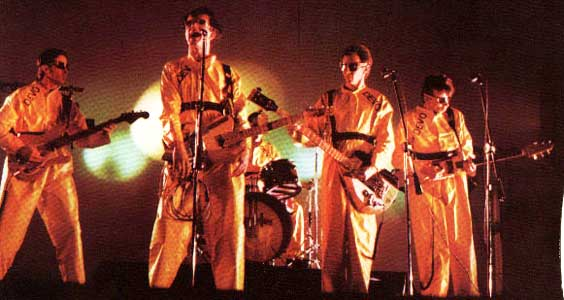 Devo - yellow jumpsuits and flower pots