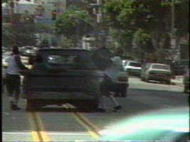 Rodney King Riots - load the tv into the truck